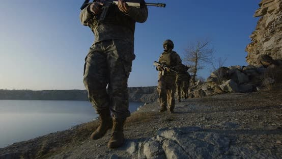 Thumbnail for Armed Soldiers Walking By a Lake
