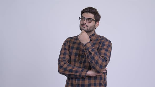 Thumbnail for Happy Young Bearded Indian Hipster Man Smiling and Thinking