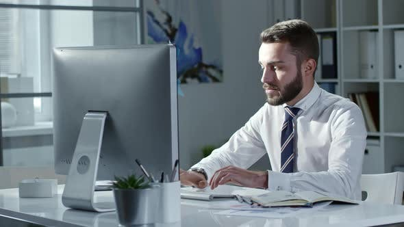 Thumbnail for Young Entrepreneur Typing on Computer in Office