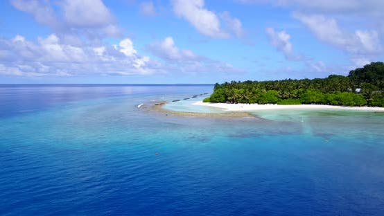 Thumbnail for Wide angle birds eye copy space shot of a white sandy paradise beach and blue ocean background in hi