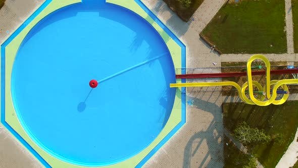 Thumbnail for Aerial view of empty pool with slides in abandoned aqua park.