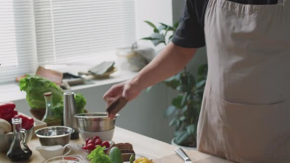 Male Chef Telling about Ingredients at Camera