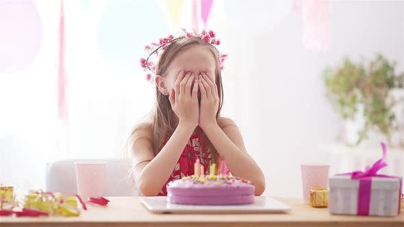 Thumbnail for Caucasian Girl Is Dreamily Smiling and Looking at Birthday Rainbow Cake. Festive Colorful Background