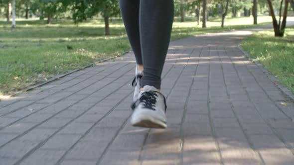 Thumbnail for Woman Jogging in Park and Listening to Music