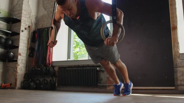 Thumbnail for Man Doing Push-ups on Gymnastic Rings in Gym