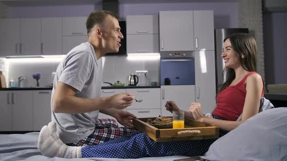 Thumbnail for Romantic Couple Eating Breakfast in Bed