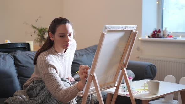 Thumbnail for Young Millennial Woman Painting with Acrylic Paints at Home