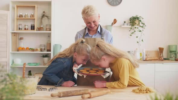 Woman Baking Cookies with Granddaughters