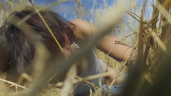 Thumbnail for Skill Woman with Short Hair Wearing Bodysuit Relaxing on the Wheat Field