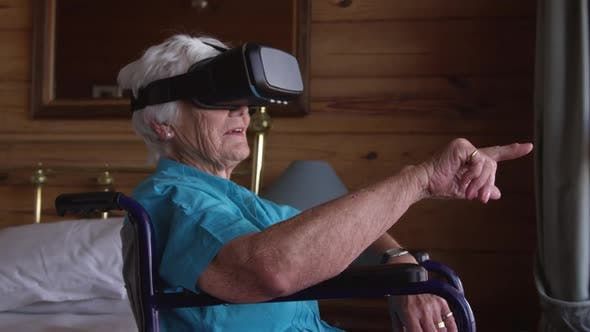 Woman using virtual reality headset at home 4k
