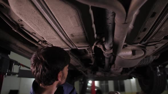 Thumbnail for Automobile Mechanic During Car Underbody Check