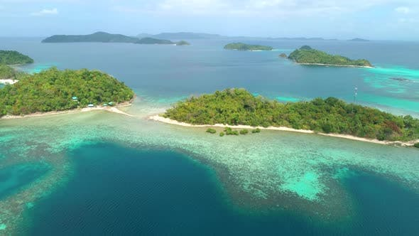 Thumbnail for Aerial View of a Tropical Island with Palm Trees and White Sand Beaches. Amazing Tropical Island in