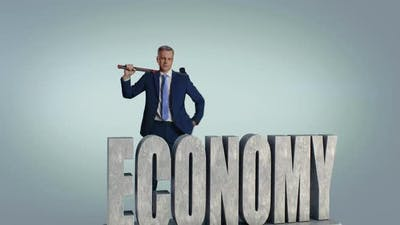 Middle Aged Businessman Breaking Economy Inscription