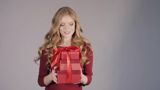 Thumbnail for Beautiful Blonde Lady in Bordo Dress Getting Birthday Gifts