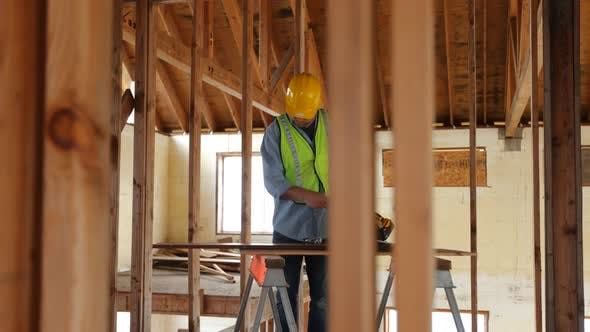 Thumbnail for Construction worker building home