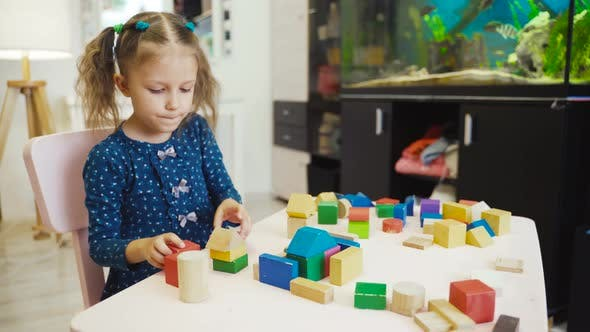 Cover Image for Little Girl Child Playing Toys Cubes At Home