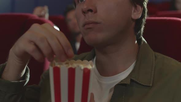 Thumbnail for Man Eating Popcorn in Cinema