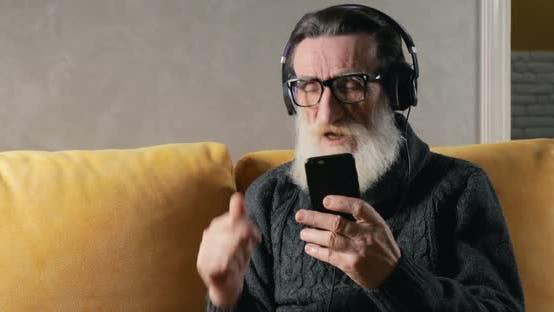Thumbnail for Elderly Man Listens To Music