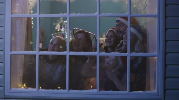 Cover Image for Happy Family Watching Fireworks Through Window