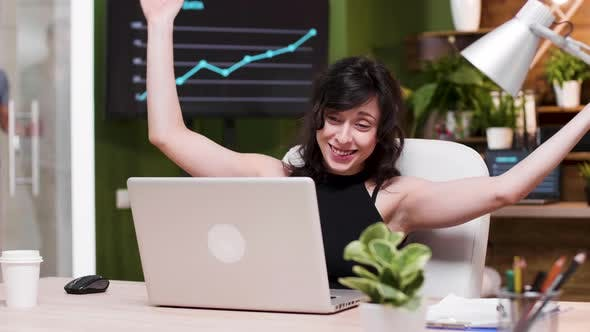 Thumbnail for Excited Female Corporate Worker Reads Good News on the Laptop