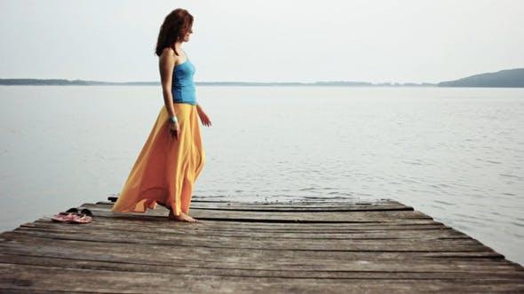 Thumbnail for Girl Waiting At Wooden Bridge