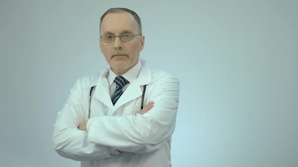 Thumbnail for Successful Confident Doctor Looking at Camera With Folded Arms, Clinic Services