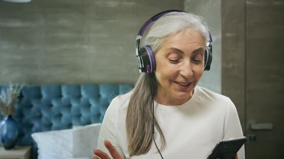 Thumbnail for Elderly Woman with Smartphone Music