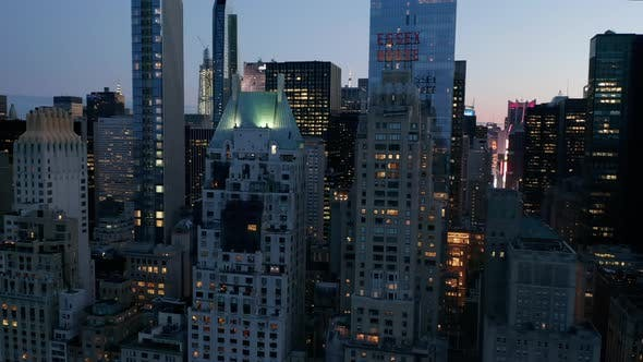 Thumbnail for AERIAL: Manhattan Skyline at Night with Flashing City Lights in New York City at Central Park