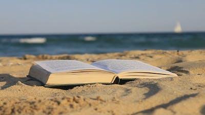 Book Of Sand On The Beach