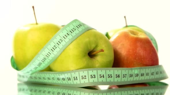 Thumbnail for Green, Fresh Apple with Measuring Tape on White, Rotation