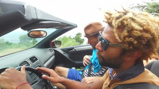 Thumbnail for Black handsome men driving his friends in convertible