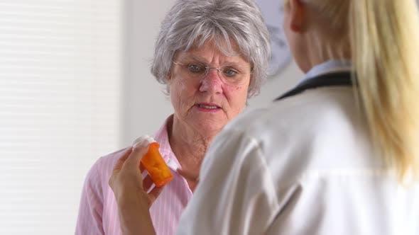 Thumbnail for Elderly patient asking doctor about prescription medicine