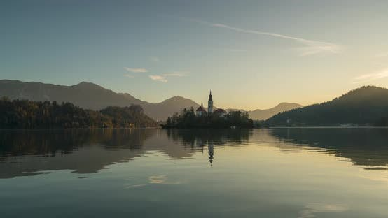 Thumbnail for Timelapse View of the Colorful Forest and Lake Bled with a Small Island with a Church. Sunrise in