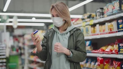 Woman in Protective Mask at the Supermarket