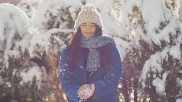 Thumbnail for Woman Throws Snowball Hitting Camera. Slow Motion High Quality Sharp Footage