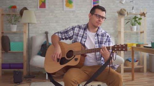 Young Musician Man Playing Guitar