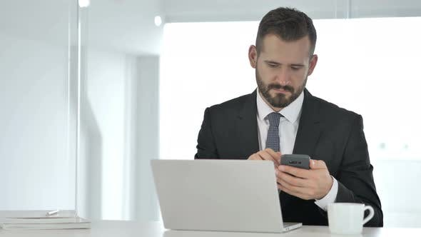 Thumbnail for Businessman Using Smartphone, Online Browsing