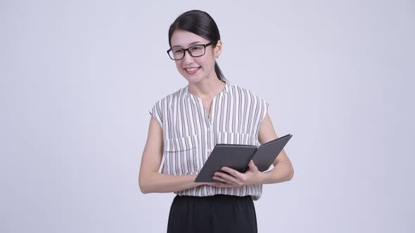 Cover Image for Happy Beautiful Asian Businesswoman As Teacher Talking and Reading Book