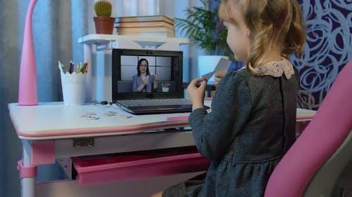 Girl Calling To Woman Teacher on Laptop Distance Education Learning at Home on Coronavirus Lockdown