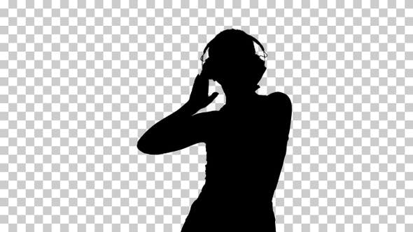 Thumbnail for Silhouette Charming girl in shorts and earphones dancing