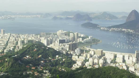 Pan of Rio and harbor from Corcovado lookout point