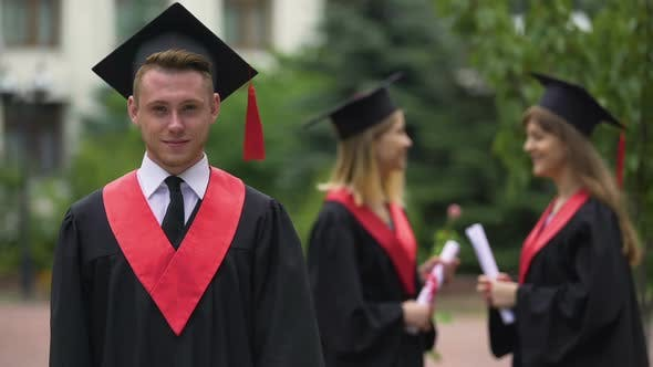 Thumbnail for Graduation Ceremony, Happy Man in Academic Dress Looking Into Camera, Laughing