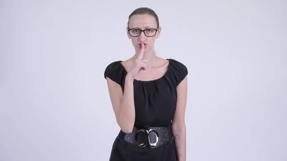 Cover Image for Portrait of Angry Blonde Businesswoman with Finger on Lips