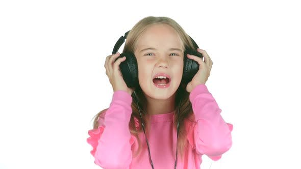 Thumbnail for Baby Listens To the Music in the Headphones. White Background. Slow Motion