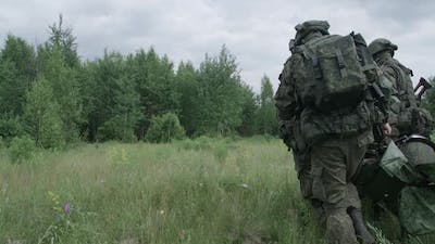 Soldiers Evacuated the Wounded Soldier in a Stretcher a Rescue Operation Under Cover Smokescreen on