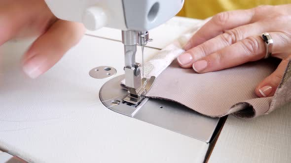 Thumbnail for Senior Female Sewing Cloth on Machine
