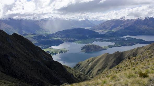 Timelapse Roys Peak near Wanaka. Background is lake and valley
