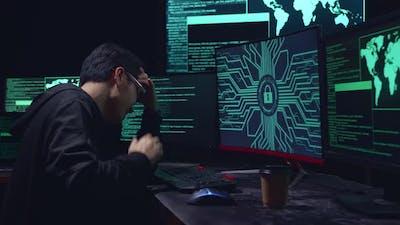 Asian Hacker Upset With Lock Key On Computer Screen