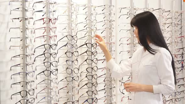 Optometrist Taking New Model of Glasses