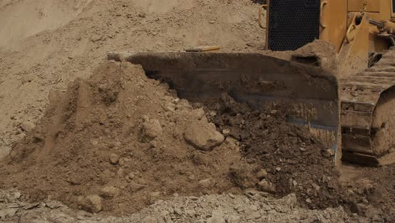 Thumbnail for A Crawler Tractor Pushes The Ground With A Bucket
